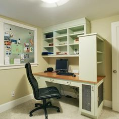 Basement office room with built-in desk and shelving.