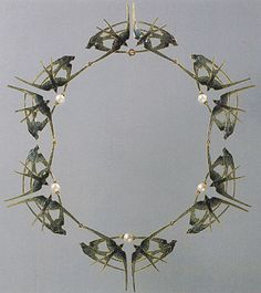 Necklace, Lalique.        I love these pieces that look a bit like alien butterflies.
