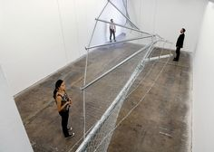 A twisting chain-link and barbed-wire fence installed by French artist and architect Didier Faustino at an exhibition in Cincinnati determines the path taken by visitors through the gallery space.
