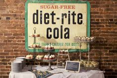 Loving this dessert bar! The vintage soda sign is to die for, and the eclectic tiered stands are great!