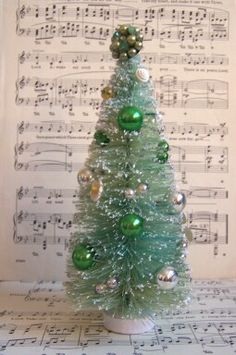 Decorated Bottle Brush Tree. The sheet music back drop really completes the picture.