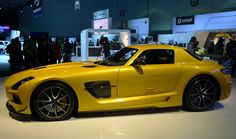 A side view of a yellow Mercedes-Benz SLS AMG Black Series