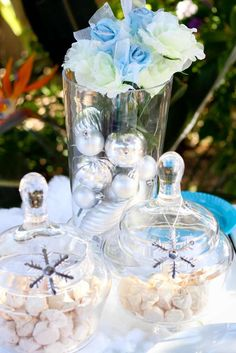 White candy jars at a Frozen birthday party! See more party planning ideas at CatchMyParty.com!