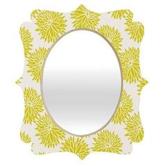 """Floral wall mirror by Khristian A. Howell for DENY Designs.   Product: MirrorConstruction Material: Engineered wood and aluminumColor: MultiFeatures:  Original design by Khristian A Howell for DENY DesignsGlossy aluminum face     Dimensions:   Small: 19.5"""" H x 14.5"""" W   Medium: 29.2"""" x 21.7""""  Large: 36"""" H x 30"""" W     Cleaning and Care: Spot clean with window cleaner"""