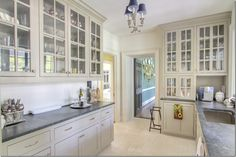catering kitchen/wet bar.  notice the painted floors.  cabinets are a putty color with just a hint of green.. hero paint color