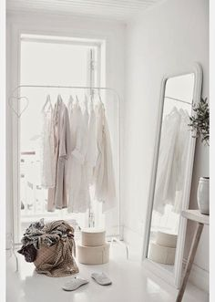 Paint mirror white like walls, pl at end. Or stick onikea. Fluffy rug on floor and couch to sit on