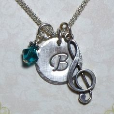 Treble Clef Music Note Hand Stamped Sterling Silver Initial Charm Necklace by DolphinMoonCreations $32 https://www.etsy.com/listing/62251517