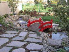 Enhance your water feature with a bridge.  Gardenbridges.com