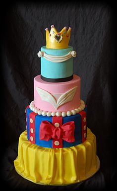 Found this on cake central:  This is my entry for our local Fairs cake contest. The theme this year is The Magical World of Disney. Each tier represents one of the princess dresses. (Cinderella, Sleeping beauty, Snowwhite and Belle) thanks for looking!