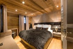 So cosy! One of the beautiful bedrooms in luxury ski chalet, Chalet Etoile in The Alps, France. www.purefrance.com