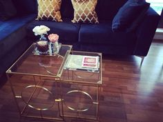 Teal sofa, yellow & gold accents, gold frame zara home coffee table