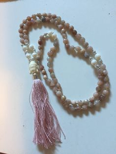 Sunstone and mother of pearl mala