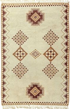 A Vintage Moroccan Rug   A late 20th century vintage Moroccan pile rug. Price: $18,000