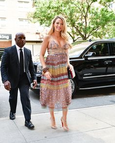 Blake Lively wearing a patterned Valentino dress paired with studded Christian Louboutin pumps while out in NYC.