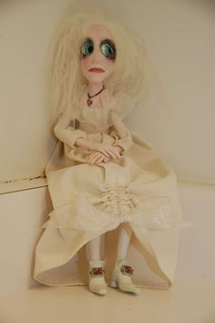 handmade doll of polymer clay and vintage fabrics