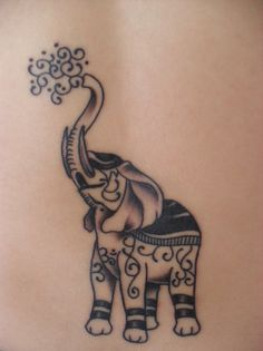 elephant tattoo with Indian festival designs...love it
