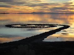 Robert Smithson, Spiral Jetty.  This is an awesome example of earth art and was created in 1970 at Rozel Point on the Great Salt Lake in Utah,  It is tons of rock placed in a spiral pattern and changes appearance from minerals and algae dependent on the level of the lake during various seasons.