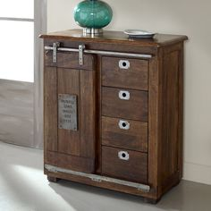 Featuring a sliding barn-style door and warm brown mango finish, this cabinet brims with rustic appeal, while its 4 drawers add versatility-it's perfect for stowing office supplies or out-the-door essentials.