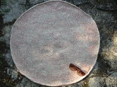 round rug made of 100 merino wool  natural color with by bossonoga, $250.00