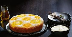 Try this fragrant citrus olive oil cake topped with luscious whipped rosemary cream.