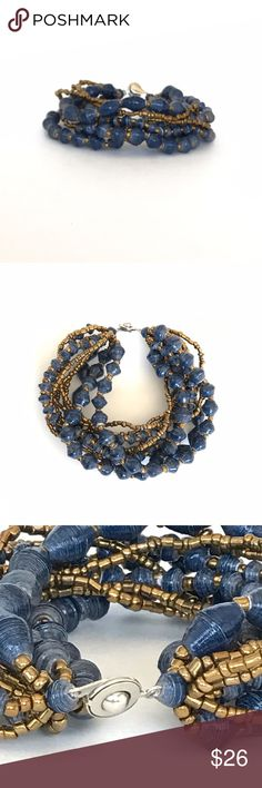 NWT Designer Handmade Multilayer Bracelet 31 bits Brand new with tags. 31 bits, designer from Nordstrom. Hand made. Made from recycled materials. 10 layers of navy blue and gold beads. Signature 31 bits metallic closure. Retail price $42.00 + tax 31 bits Jewelry Bracelets