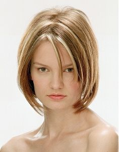 Cute bob haircut with chunky blonde highlights.
