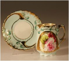 Cream with gold accents and pink flowers demitasse cup and saucer