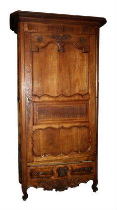 Found on EstateSales.NET: Antique French Provincial bonnetiere armoire