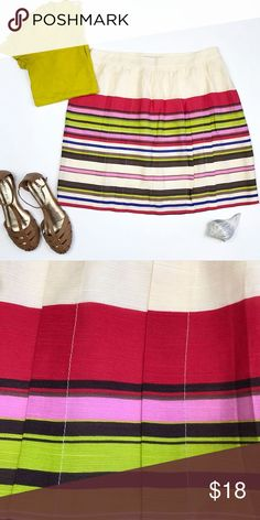 Loft cream striped skirt sz 12 This skirt screams spring and summer to me! Easily pair with a solid color top for an easy look! . Loft / size 12 . Rayon, lyocell, nylon blame cream with bright stripes skirt. Lined. Side zip. Pleating details down front. . Waist 17, length 20.5 LOFT Skirts