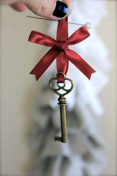 Something different: the groom wears a key on his boutonniere and the bride has the lock to it on her bouquet.