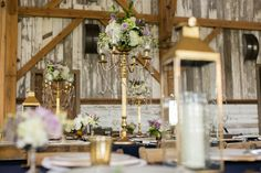 @mikaellabridal   Real #Bride Sonya's Centerpieces from her #weddingday. Such an elegant piece with the bouquet of flowers on a gold stand. Perfect for barn, outdoor, or indoor chic wedding!
