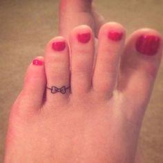 Tiny tattoo on the toe