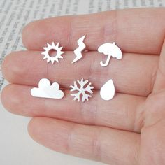 weather earrings set. These remind me of Ms. Frizzle from the Magic School Bus!