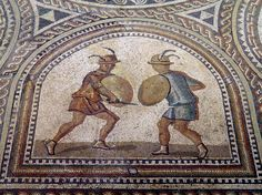 Detail of Gladiator mosaic, two Eques fighting equipped with lance, sword and the traditional small round shield, Römerhalle, Bad Kreuznach, Germany
