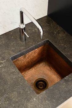 Thinking a hammered copper sink however extending that finish across the whole worktop surface in the laundry