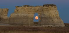 """Last night's """"supermoon"""" is seen through the arch of Monument Rocks in Gove County, Kansas.  Photography by Greg Holmes."""