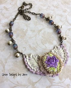 Vintage Flair .. A beautiful rose cab with rhinestone around it is mounted onto lace and then mounted onto a beautiful component .. glass beads, pearls and brass chain complete this beauty .. FOR SALE $48.00 https://www.etsy.com/shop/CleverDesignsbyJann