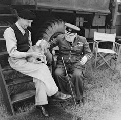 WINSTON CHURCHILL VISITS NORMANDY AUGUST 1944 (B 8766) Prime Minister Winston Churchill and General Sir Bernard Montgomery & his dog (named Rommel) in Normandy at Montgomery's caravan at his headquarters at Chateau Creully, 7 August 1944