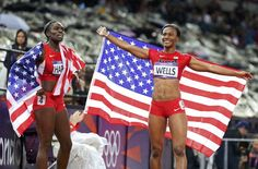 Dawn Harper (L) and Kellie Wells of the U.S. celebrate after the women's 100m hurdles final during the London 2012 Olympic Games on August 7, 2012. Harper won silver and Wells won bronze.