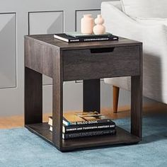Our solid wood Pure Storage Side Table features an open shelf and a roomy drawer, plus ample room for a lamp, a stack of books and a drink. The carbon finish allows the rich, variegated grain of the mango wood to peek through. Industrial Side Table, Rustic Side Table, Side Coffee Table, Black Side Table, Industrial Storage, Chair Side Table, Side Tables, Table Shelves, Table Storage