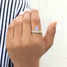 A small tear drop shape Moonstone Gemstone decked in Sterling Silver Ring. A light weight ring for casual wear. Rainbow Moonstone Ring, Blue Topaz Ring, Sterling Silver Earrings, Silver Rings, Casual Rings, Bohemian Rings, June Birth Stone, Dainty Ring, Swarovski Jewelry