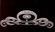 A diamond and platinum tiara, composed of a central openwork oval motif of graduated circular-cut diamonds within a tapering line of smaller diamonds above and below and supporting in the centre a large marquise-cut diamond within two graduated oval haloes, a large circular-cut collet below, and to either side three graduated stylised 'C' scroll motifs, each with a central marquise collet set throughout with brilliant-cut diamonds, probably French, Circa 1912.