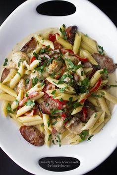 Rustic Chicken Pasta with Bacon & Sausage   landeelu.com This looks amazing!