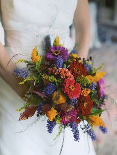 Zinnia , butterfly bush and cockscomb bridal bouquet