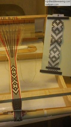 Inkle weaving with pick up using a rigid heddle.