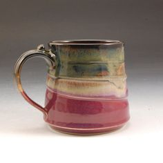 Large Plum red and golden brown Handmade porcelain Stoneware Pottery Mug by Mark Hudak  Mugs are probably the most intimate piece of pottery we potters make. We come in contact closely with them every time we use them. You will looks forward to your daily cup of jo or tea or what ever. Nicely balance and easily controlled with 2 fingers and a thumbstop to balance easily.  Formed on the potters wheel.  A generous mug. 15-16 oz. 4 by 4 at the mouth.  Microwave and dishwasher safe. Completely…