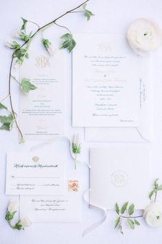 Traditional White and Gold Monogramed Invitations  https://www.thecelebrationsociety.com/weddings/sweet-traditional-blush-wedding-ritz-carlton-sarasota-sarasota-fl/