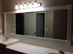 Framed the mirror and updated the wall color in my master bath.
