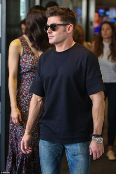 Leading the charge: Zac cut a casual figure in his slim fit tee while Alexandra followed behind him in her ditzy print dress