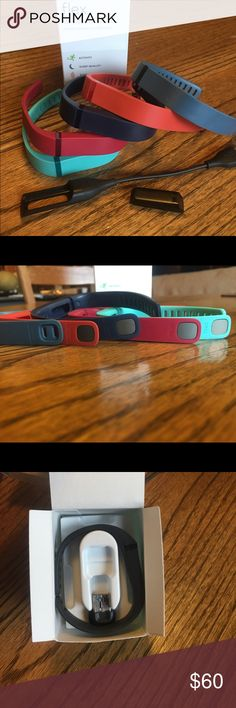 FITBIT wireless wristband & 5 Fitbit bands This fit bit tracking system and five bands are gently used. All bands are size large. Comes with original box. Purchased at Verizon wireless.  There is a black wristband in a small size and a USB thumb drive included also. All bands were purchased off of Fitbit.com. fitbit Other